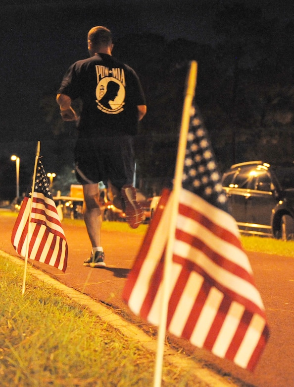 A Keesler member runs laps during Keesler's POW/MIA 24-hour memorial run and vigil at the Crotwell Track Sept. 16, 2016, on Keesler Air Force Base, Miss. Over 400 Keesler personnel participated in the event, to include runners and readers. Participants ran more than 1,500 miles and raised $1,400, which will be donated to a POW/MIA memorial fund. (U.S. Air Force photo by Kemberly Groue/Released)