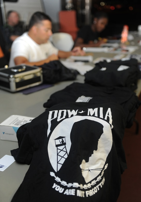 A t-shirt sits on display during Keesler's POW/MIA 24-hour memorial run and vigil at the Crotwell Track Sept. 16, 2016, on Keesler Air Force Base, Miss. More than 400 Keesler personnel participated in the event, to include runners and readers. Participants ran more than 1,500 miles and raised $1,400, which will be donated to a POW/MIA memorial fund. (U.S. Air Force photo by Kemberly Groue/Released)