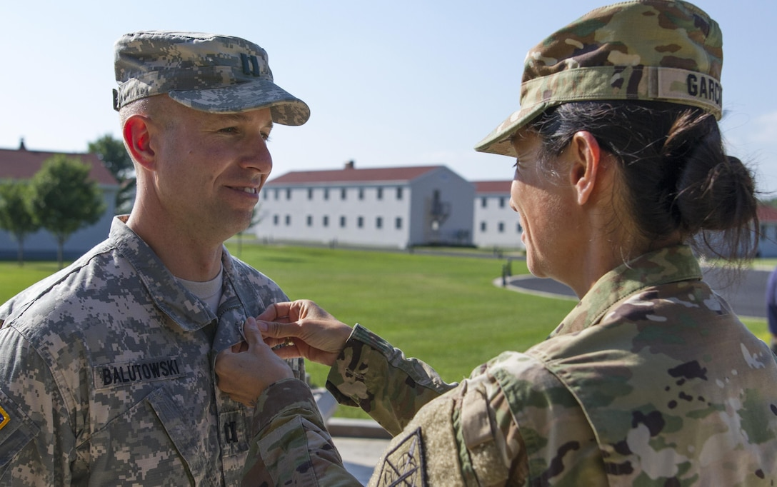 U.S. Army Reserve Brig. Gen. Marion Garcia, commander of the 200th Military Police Command, pins the Army Commendation Medal on Capt. James Balutowski, the operations officer for the 304th MP Battalion, July 18 during Warrior Exercise 86-16-03 at Fort McCoy, Wisc. Balutowski was awarded the General Douglas MacArthur Leadership Award for 2015. (U.S. Army Photo by Sgt. 1st Class Jacob Boyer)