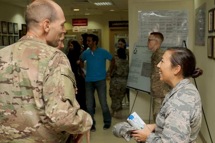 Air Force Capt. Gina McComb, a bioenvironmental engineer in the 386th Expeditionary Medical Group, briefs a Soldier during the U.S. Military Hospital-Kuwait Healthcare Symposium, September 4. The symposium was hosted by the 10th Combat Support Hospital to provide an open forum to healthcare professionals in all military branches and Kuwaiti professionals.