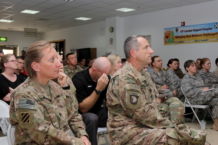 Maj. Gen. William Hickman, U.S. Army Central deputy commanding general-operations, listens to a brief during the U.S. Military Hospital-Kuwait Healthcare Symposium. The symposium was hosted by the 10th Combat Support Hospital to provide an open forum to healthcare professionals in all military branches and Kuwaiti professionals.