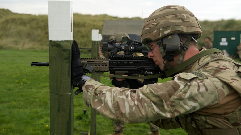 A Royal Marine fires a SA80 A2 rifle, Sept. 13, 2016, at Altcar Training Camp, Merseyside, England. The Marines are participating in the Royal Marines Operational Shooting Competition from Sept. 6-22, 2016.  The Royal Marines are competing against the Royal Netherlands Marine Corps and the U.S. Marines.