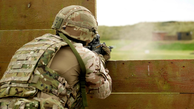 A Royal Marine fires a SA80 A2 rifle in the supported kneeling position in a practice match during the Royal Marines Operational Shooting Competition, Sept. 12, 2016, The Royal Marines are competing against and building bonds with the Royal Netherlands Marine Corps and the U.S. Marines.
