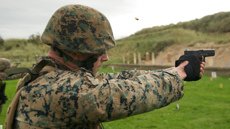 Sgt. Chris Anderson, a competitor with the Marine Corps Shooting Team, fires a Glock 17 at a practice match during the Royal Marines Operational Shooting Competition, Sept. 12, 2016, at Altcar Training Camp, Merseyside, England. The competition is from September 6 - 22, 2016.  The U.S. Marines are competing against and building bonds with the Royal Netherlands Marine Corps and the Royal Marines. Anderson is with Weapons Training Battalion, Marine Corps Base Quantico, Virginia.