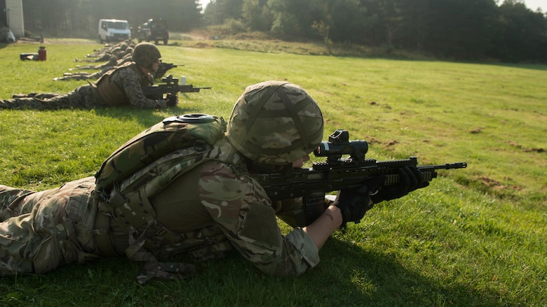 Royal Marines and U.S. Marines with the Marine Corps Shooting Team prepare to fire Sept. 14, 2016, at Altcar Training Camp, Merseyside, England. The Marines are competing in the Royal Marines Operational Shooting Competition, from September 6-22, 2016.  The U.S. Marines are competing against the Royal Netherlands Marine Corps and the Royal Marines. The U.S. Marines are with Weapons Training Battalion, Marine Corps Base Quantico, Virginia.