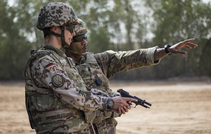 Maj. Annika Heusinger, a German army officer and competitor for the German Armed Forces Proficiency Badge, finds her targets during the M9 pistol marksmanship event Aug. 4, 2016 at Camp Arifjan, Kuwait. The marksmanship event was the fourth and last test soldiers had to pass to earn the foreign badge. (U.S. Army photo by Sgt. Angela Lorden)