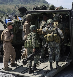 Philippine Marines board a U.S. Marine Corps Amphibious Assault Vehicle with Combat Assault Battalion, 3rd Marine Division, III Marine Expeditionary Force during Balikatan 16 at Crow Valley, Philippines, April 4, 2016. This training familiarized the Philippine Marines with the capabilities of the AAV employed by the U.S. Marines. Through our enduring partnership, the U.S. and Philippines are postured to rapidly deploy in response to real world crises across the military spectrum from natural disasters to conflict throughout the Indo-Asia-Pacific region.