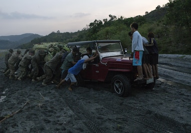 U.S. Marines, Soldiers and a Sailor assist a local Philippine family during Balikatan 16 at Crow Valley, Philippines, April 4, 2016. While U.S. service members were conducting bilateral training, they stopped help a Philippine family get their vehicle out of the mud. Balikatan provides opportunities for U.S. and Philippine forces to learn from each other and train for potential real world crises, better preparing them to support the local population throughout the Indo-Asia-Pacific region.