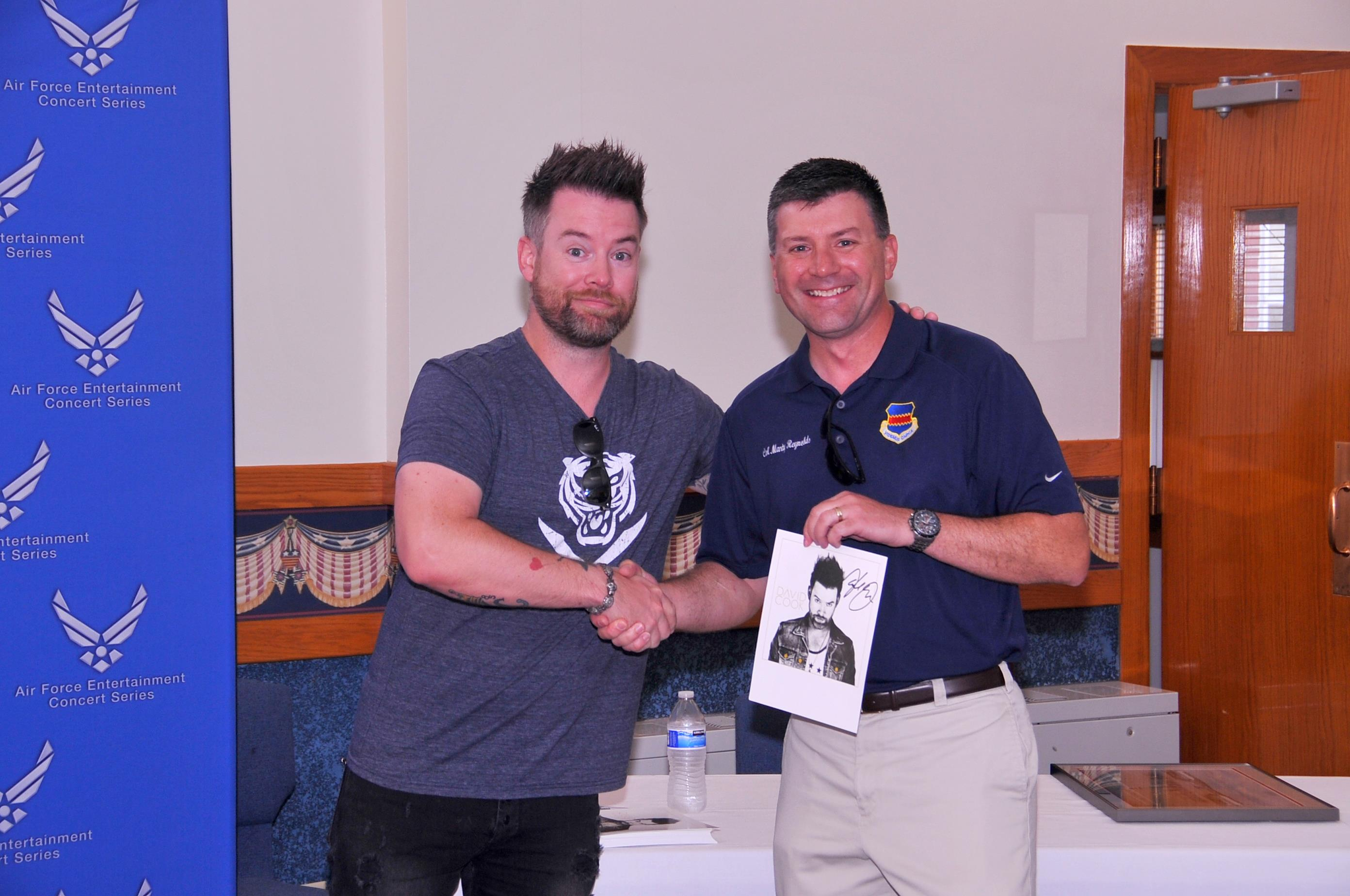 Photos 55th wing commander col marty reynolds right is presented with an autographed photo m4hsunfo