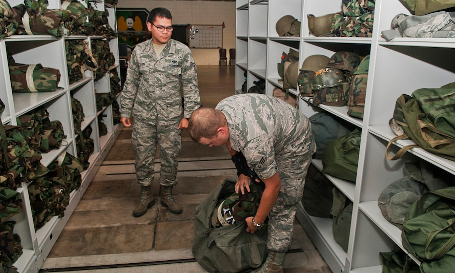 Senior Airman Zachary Hazuka, a central storage apprentice with the 5th Logistics Readiness Squadron, packs deployment training gear into a duffle bag at Minot Air Force Base, N.D., Sept. 6, 2016. The IPE shop is responsible for issuing out chemical gear for all deploying Airmen. (U.S. Air Force photo/Airman 1st Class Jonathan McElderry)