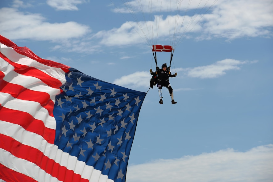 Dana Bowman, retired sergeant first class with the U.S. Army and well-renowned skydiver, descends on Sheppard Air Force Base, Texas, Sept. 17, 2016. Bowman jumped along with the Air Force Wings of Blue Parachute Team to open the 75th Anniversary Air Show celebration. (U.S. Air Force photo by Senior Airman Kyle E. Gese)