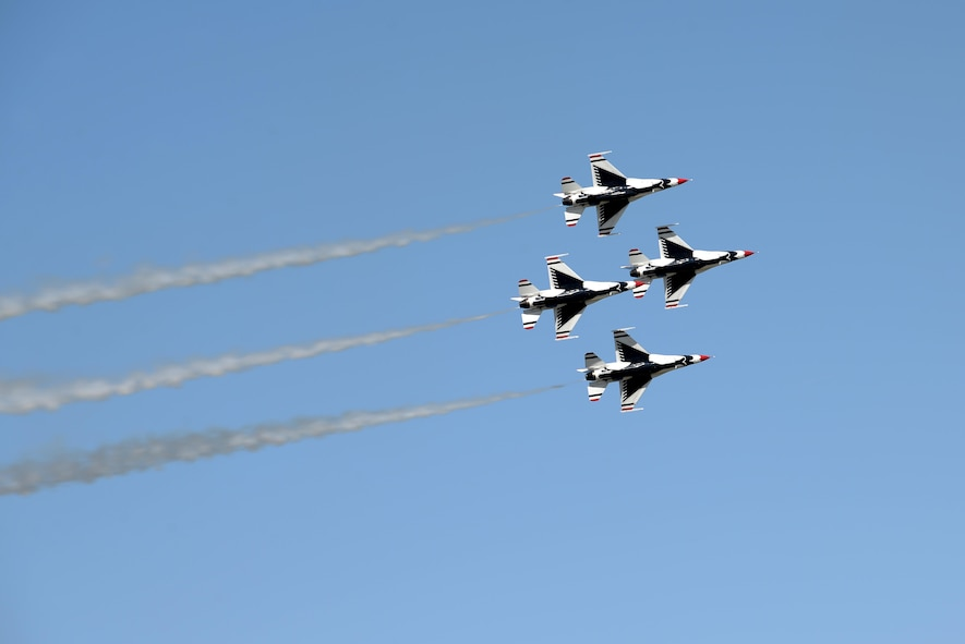 Four of the six U.S. Air Force Thunderbirds fly in a close air formation during the Sheppard Air Force Base, Texas, 75th Anniversary Air Show Celebration, Sept. 17, 2016. The Thunderbirds showcase the skill and precision of the brave aviators, maintenance and support Airmen who deploy abroad to defend our nation and its allies. (U.S. Air Force photo by Senior Airman Kyle E. Gese)
