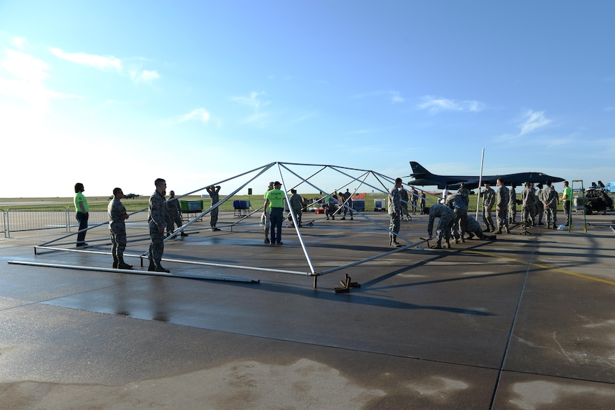 U.S. Air Force Airmen help set up tent poles after a storm blew down nearly every tent for the Sheppard Air Force Base, Texas, Open House and Air Show, Sept. 18, 2016. More than 2,000 Airmen in Training gathered to help reset the base for the 75th Anniversary Air Show Celebration. (U.S. Air Force photo by Senior Airman Kyle E. Gese)