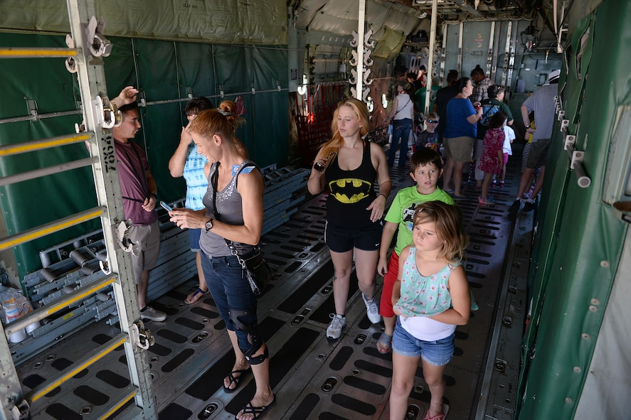 People from Wichita Falls and neighboring communities tour the different aircraft during the 75th Anniversary Air Show Celebration at Sheppard Air Force Base, Texas, Sept. 18, 2016. The celebration had numerous performers such as the Tora Tora Tora Pearl Harbor reenactment, the Air Force Wings of Blue, skydiver Dana Bowman, Viper Air Show jet car and solo demo, Randy Ball's Mig 17 and Vietnam T-37 demo, Kent Pietsch Jelly Belly comedy air act, Texas Raiders B-17 WWII demo, Freedom Flyers P-51 WWII demo, and the world-famous U.S. Air Force Thunderbirds. (U.S. Air Force photo by Senior Airman Kyle E. Gese)