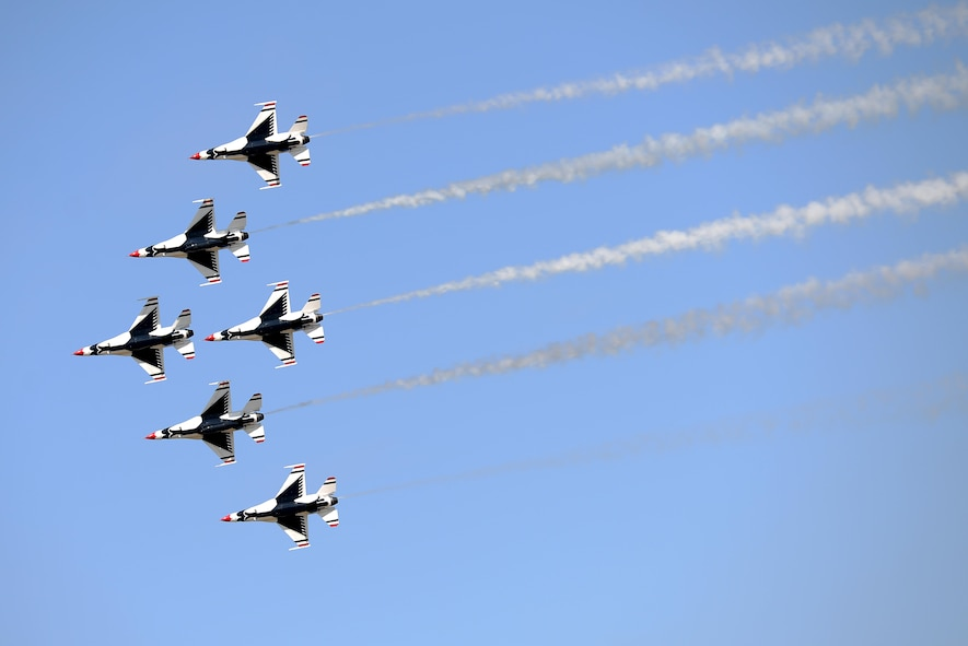 All six U.S. Air Force Thunderbirds fly in a close air formation during the Sheppard Air Force Base, Texas, 75th Anniversary Air Show Celebration, Sept. 17, 2016. The Thunderbirds showcase the skill and precision of the brave aviators, maintenance and support Airmen who deploy abroad to defend our nation and its allies. (U.S. Air Force photo by Senior Airman Kyle E. Gese)