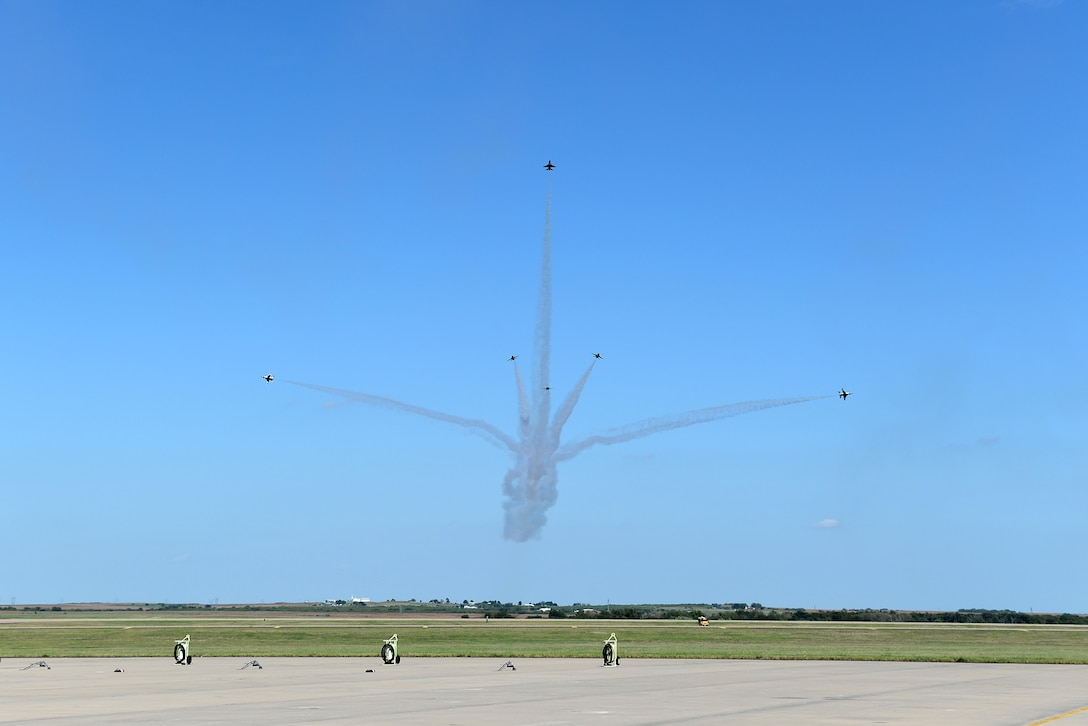 The U.S. Air Force Thunderbirds perform their delta burst formation during the Sheppard Air Force Base, Texas, 75th Anniversary Air Show Celebration, Sept. 17, 2016. The Thunderbirds showcase the skill and precision of the brave aviators, maintenance and support Airmen who deploy abroad to defend our nation and its allies. (U.S. Air Force photo by Senior Airman Kyle E. Gese)