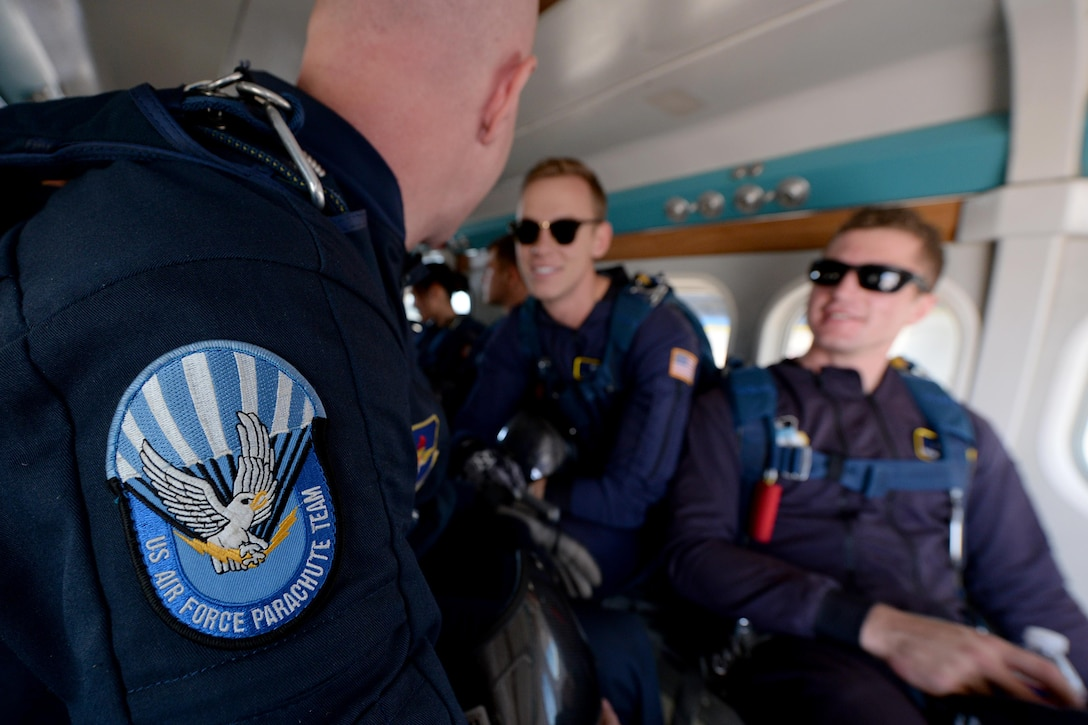 The U.S. Air Force Wings of Blue parachute team prepares to exit a UV-18B Twin Otter aircraft during the Sheppard Air Force Base, Texas, practice air show, Sept. 16, 2016. The team of jumpers performed several different maneuvers from different heights as part of the 75th Anniversary Air Show celebration. (U.S. Air Force photo by Senior Airman Kyle E. Gese)