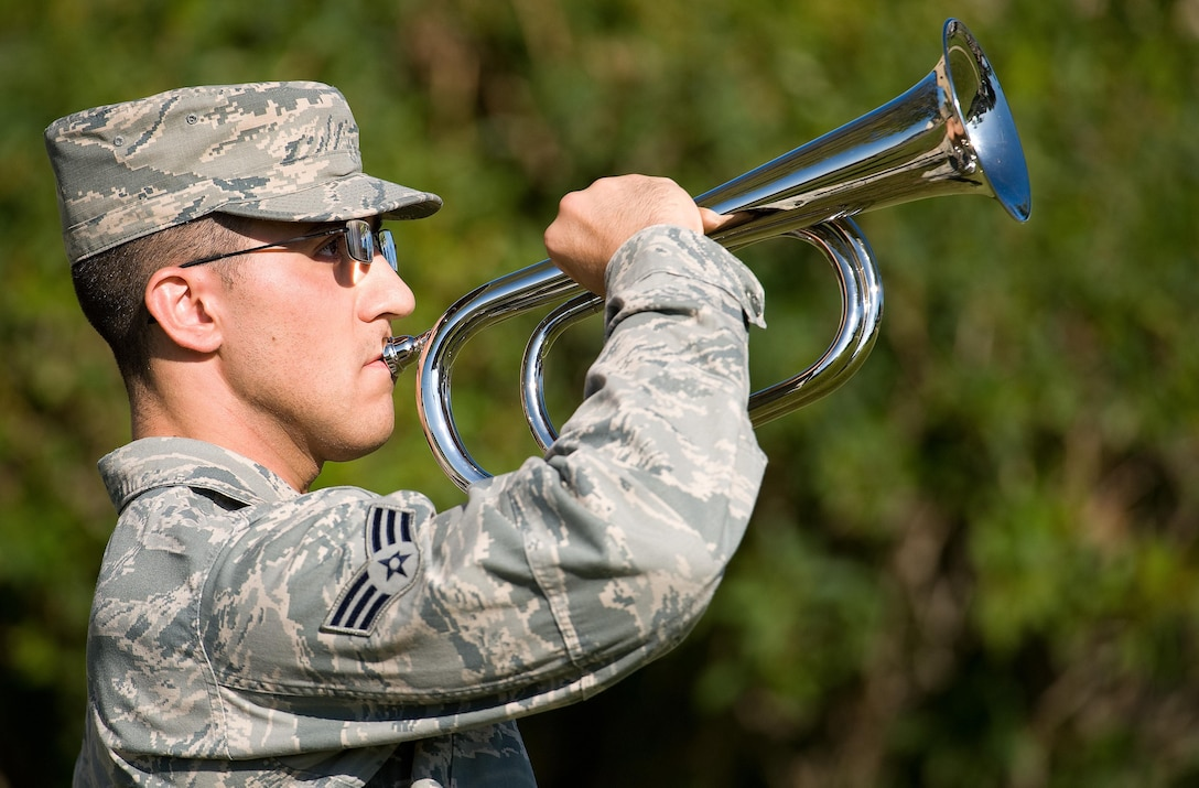 Senior Airman Warren Darrow, 9th Airlift Squadron loadmaster, plays Taps during a retreat ceremony commemorating National POW/MIA Recognition Day Sept. 16, 2016, on Dover AFB, Del. Darrow, a member of the Dover Air Force Base Honor Guard as well, was one of many Team Dover members that participated in the ceremony, 10-hour vigil and 24-hour run. (U.S. Air Force photo by Roland Balik)