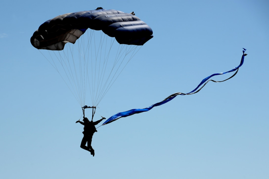 A member of the U.S. Air Force Wings of Blue parachute team descends on Sheppard Air Force Base, Texas, during the 75th Anniversary Air Show Celebration, Sept. 17, 2016. The Wings of Blue opened the Air Show with a demonstration with Dana Bowman, retired sergeant first class with the U.S. Army and well-renowned skydiver. (U.S. Air Force photo by Senior Airman Kyle E. Gese)