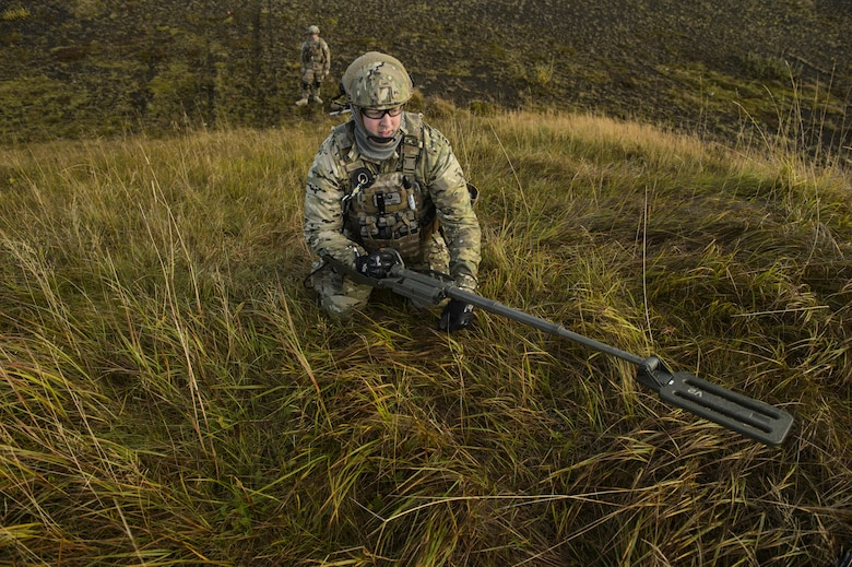 U.S. Air Force Tech. Sgt. Jason Umlauf, 52nd Civil Engineer Squadron explosive ordnance disposal craftsman, Spangdahlem Air Base, Germany, sweeps an area with a mine detector during Northern Challenge 16 exercise at Icelandic Coast Guard Keflavik Facility, Iceland, Sept. 19, 2016. The exercise focused on disabling improvised explosive devices in support of counter-terrorism tactics to prepare Partnership for Peace, NATO, and Nordic nations for international deployments and defense against terrorism. (U.S. Air Force photo by Staff Sgt. Jonathan Snyder)