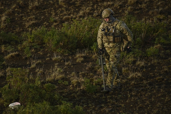 U.S. Air Force Tech. Sgt. Jason Umlauf, 52nd Civil Engineer Squadron explosive ordnance disposal craftsman, Spangdahlem Air Base, Germany, sweeps an area with a mine detector during Northern Challenge 16 exercise at Icelandic Coast Guard Keflavik Facility, Iceland, Sept. 19, 2016. The 52nd EOD, provides an operational explosive ordnance disposal capability to locate, identify, render safe, recover, field evaluate and dispose of all explosive ordnance. (U.S. Air Force photo by Staff Sgt. Jonathan Snyder)