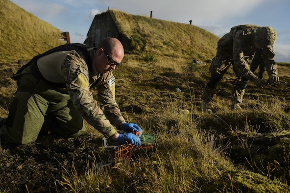 U.S. Air Force Tech. Sgt. Jason Umlauf, left, and Senior Airman Kyle Koski, 52nd Civil Engineer Squadron explosive ordnance disposal, Spangdahlem Air Base, Germany, collect evidence from a detonated improvised explosive devices during Northern Challenge 16 exercise at Icelandic Coast Guard Keflavik Facility, Iceland, Sept. 19, 2016. The exercise focused on disabling improvised explosive devices in support of counter-terrorism tactics to prepare Partnership for Peace, NATO, and Nordic nations for international deployments and defense against terrorism. (U.S. Air Force photo by Staff Sgt. Jonathan Snyder)