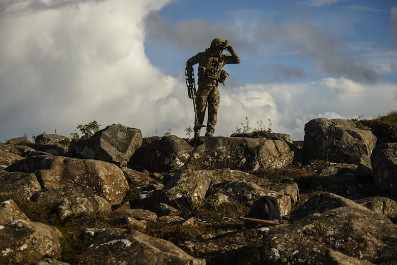 U.S. Air Force Staff Sgt. Cole Carroll, 52nd Civil Engineer Squadron explosive ordnance disposal craftsman, Spangdahlem Air Base, Germany, scans the area for additional threats after locating an improvised explosive device during Northern Challenge 16 exercise at Icelandic Coast Guard Keflavik Facility, Iceland, Sept. 19, 2016. The 52nd EOD, provides an operational explosive ordnance disposal capability to locate, identify, render safe, recover, field evaluate and dispose of all explosive ordnance. (U.S. Air Force photo by Staff Sgt. Jonathan Snyder)