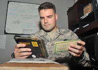 U.S. Air Force Senior Airman George Henry Lintala III, 325th Aircraft Maintenance Squadron supply journeyman, carefully identifies an aircraft part with its serial number code at the 43rd Aircraft Munitions Unit on Tyndall AFB, Fla., Sept. 12, 2016. In Airman Leadership School, Lintala learned the transformational leadership style of idealized Inspiration. Once he receives a subordinate, he plans practice this leadership style by demonstrating proper Air Force principles. (U.S. Air Force photo by Senior Airman Ty-Rico Lea/Released)