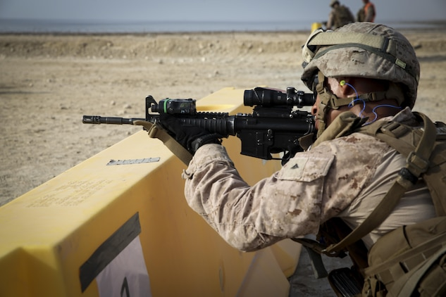 A Marine with Security Forces Company, Marine Wing Support Squadron-373, Special Purpose Marine Air Ground Task Force-Crisis Response-Central Command, sights in on his target during a live-fire and maneuver range while forward deployed, July 18, 2016. SPMAGTF – CR – CC is a self-sustaining expeditionary unit, designed to provide a broad range of crisis response capabilities throughout the Central Command area of responsibility, using organic aviation, logistical, and ground combat assets. (Photo by Cpl. Danielle Rodrigues/ Released)