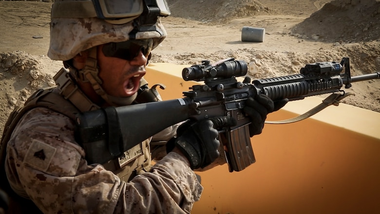 A Marine with Security Forces Company, Marine Wing Support Squadron-373, Special Purpose Marine Air Ground Task Force-Crisis Response-Central Command, shouts a command at his partner during buddy rushes while conducting a live-fire and maneuver range, July 18, 2016. SPMAGTF – CR – CC is a self-sustaining expeditionary unit, designed to provide a broad range of crisis response capabilities throughout the Central Command area of responsibility, using organic aviation, logistical, and ground combat. (Photo by Cpl. Danielle Rodrigues/ Released)