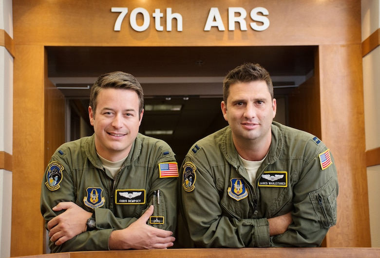 Capt. Jared Wahleithner (right) and 1st Lt. Christopher Dempsey, KC-10 Extender pilots with the 70th Air Refueling Squadron, used years of aircrew survival and first aid and buddy care training to help rescue an aircraft crash victim Sept. 17, 2016. The Citizen Airmen were taking part in the annual Clear Lake Splash In at Clear Lake, Calif., when a seaplane crashed during an attempted water landing. (U.S. Air Force photo by Ken Wright)