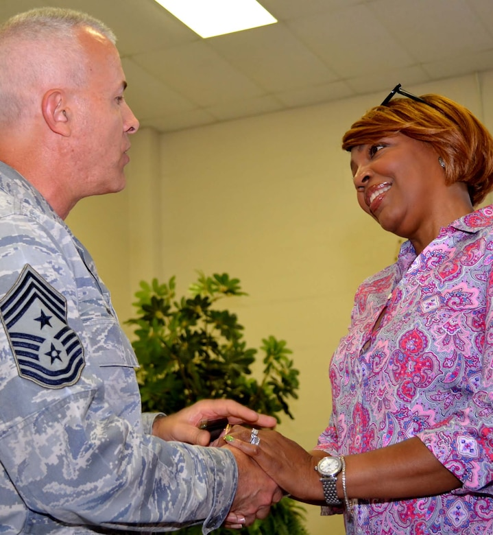 Pa. Air National Guard Command Chief Victor Guerra, of the 171st Air Refueling Wing, Coraopolis, Pa., acknowledge the sacrifices made by Yvette Fisher, wife of Master Sgt. Sylvester Fisher, the 111th Attack Wing student flight monitor, after her husband was awarded the Pennsylvania Gen. William Moffat-Reilly Medal during a ceremony in the Wing headquarters building at Horsham Air Guard Station, Pa., Sept. 10, 2016. The medal is awarded to the service member with the longest continuous service in the Pa. National Guard – Army or Air Force. (U.S. Air Force photo by Tech. Sgt. Andria Allmond)