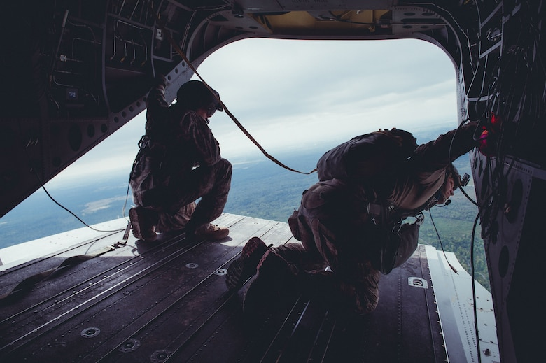 Airmen from the 274th Air Support Operations Squadron, Syracuse, N.Y., conduct air assault and parachute jump training out of a CH-47 Chinook helicopter from the 1-169th General Support Aviation Battalion, Rochester, N.Y., Sept. 10, 2016. The training is part of an annual requirement for parachute jumps, and a larger exercise involving the Civil Air Patrol acting as close air support. (U.S. Air Force photo by Staff Sgt. Ryan Campbell)