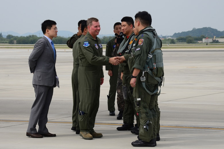 Republic of Korea F-15K Slam Eagle pilots are greeted by U.S. Air Force Lt. Gen. Thomas W. Bergeson, 7th Air Force Commander, following a landing of the B1-B Lancer at Osan Air Base, Republic of Korea, Sept. 21, 2016. ROKAF F-15s and U.S. Air Force F-16 Fighting Falcons escorted the B1-B, which is deployed from Andersen Air Base, Guam, over Osan before landing. The flight was the closest a B-1 has ever flown to the border between the Republic of Korea and North Korea. (U.S. Air Force photo by Staff Sgt. Rachelle Coleman)