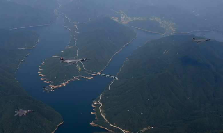 Two U.S. Air Force B-1B Lancers deployed to Andersen Air Base, Guam, and two F-15K Slam Eagles assigned to Daegu Air Base, Republic of Korea, fly over ROK skies Sept. 21, 2016. The flight was the closest a B-1 has ever flown to the border between the ROK and North Korea. The B-1 is the backbone of the U.S. long-range bomber mission and is capable of carrying the largest payload of both guided and unguided weapons in the Air Force inventory. (Republic of Korea air force photo by Chief Master Sgt. Kim, Kyeong Ryul)