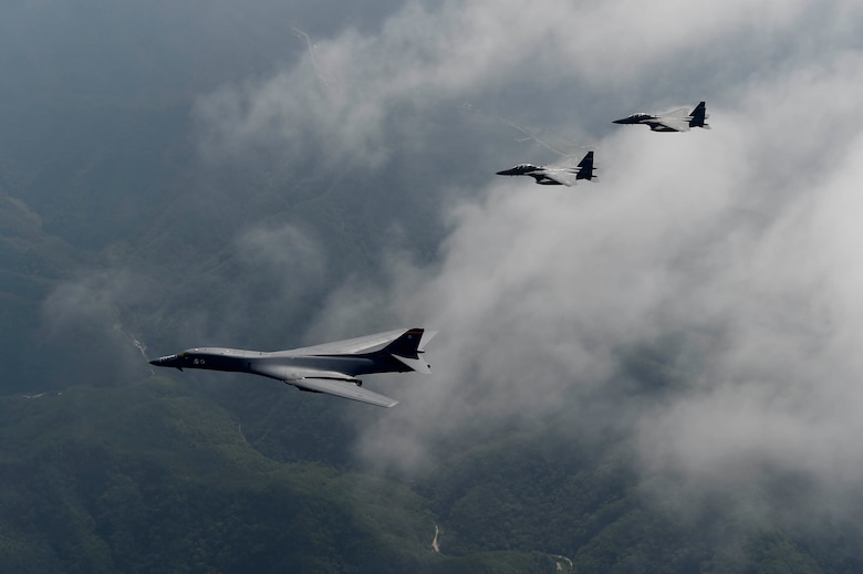 A U.S. Air Force B-1B Lancer deployed to Andersen Air Base, Guam, is flanked by two F-15K Slam Eagles assigned to Daegu Air Base, Republic of Korea, during flight over ROK skies Sept. 21, 2016. The flight was the closest a B-1 has ever flown to the border between the ROK and North Korea. The B-1 is the backbone of the U.S. long-range bomber mission and is capable of carrying the largest payload of both guided and unguided weapons in the Air Force inventory. (Republic of Korea air force photo by Chief Master Sgt. Kim, Kyeong Ryul)