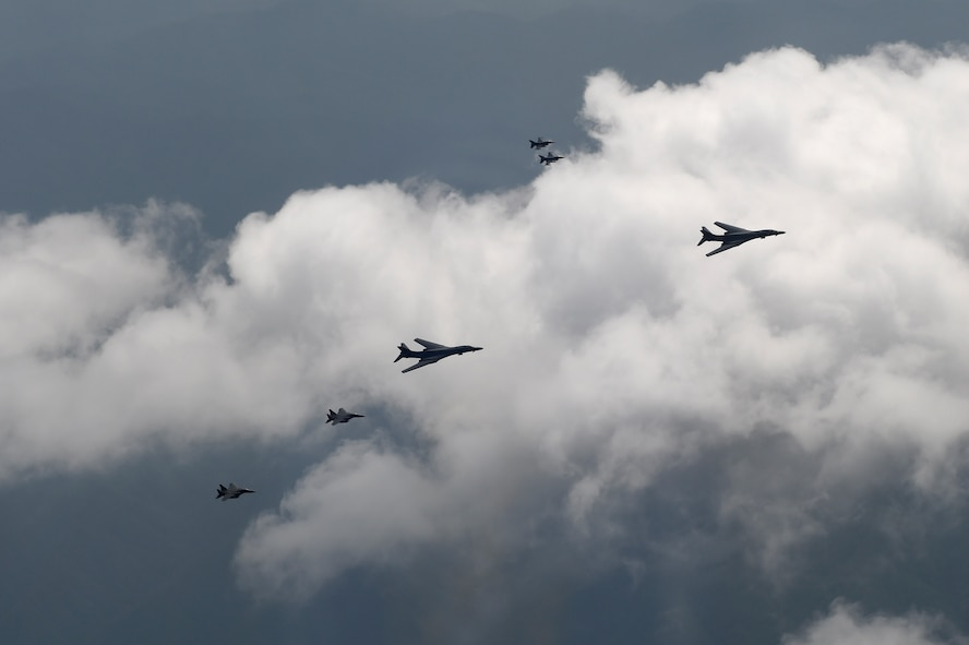 A formation of two B-1B Lancers deployed to Andersen Air Base, Guam, and four F-15K Slam Eagles assigned to Daegu Air Base, Republic of Korea, fly over ROK skies Sept. 21, 2016. The flight was the closest a B-1 has ever flown to the border between the ROK and North Korea. The B-1 is the backbone of the U.S. long-range bomber mission and is capable of carrying the largest payload of both guided and unguided weapons in the Air Force inventory. (Republic of Korea air force photo by Chief Master Sgt. Kim, Kyeong Ryul)