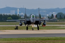 A Republic of Korea air force F-15K Slam Eagle taxis off the runway at Osan Air Base, Republic of Korea, Sept. 21, 2016. Several fighter aircraft, including the F-15K, escorted a B-1B Lancer deployed from Andersen Air Base, Guam, to Osan after a mission flying the B-1 closest to the North Korean border ever. (U.S. Air Force photo by Senior Airman Victor J. Caputo)