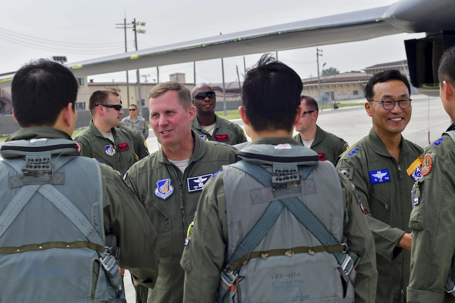 Lt. Gen. Thomas W. Bergeson, 7th Air Force commander, and Republic of Korea air force Maj. Gen. Hong, Jae Ki, Republic of Korea Air Forces Operations Center vice commander, greet F-15K Slam Eagle pilots after a mission escorting a U.S. Air Force B-1B Lancer to Osan Air Base, Republic of Korea, Sept. 21, 2016. The B-1, which is the operational backbone of the U.S. long-range bomber mission, had just conducted its closest flight to the North Korean border ever. (U.S. Air Force photo by Senior Airman Victor J. Caputo)