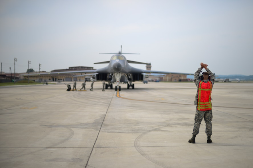 U.S. Air Force Staff Sgt. Justin Shields, 34th Expeditionary Aircraft Maintenance Unit crew chief, marshals a B-1B Lancer into a parking spot at Osan Air Base, Republic of Korea, Sept. 21, 2016. The B-1 had just conducted its closest flight to the North Korean border ever, as well as landing on the Korean Peninsula for the first time since 1996. The B-1 is deployed from Andersen Air Base, Guam. (U.S. Air Force photo by Senior Airman Victor J. Caputo)