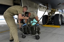 Two maintenance Airmen from the 34th Expeditionary Aircraft Maintenance Unit at Anderson Air Base, Guam, check hydraulic fluid during a post-flight inspection on a B-1B Lancer at Osan Air Base, Republic of Korea, Sept. 21, 2016. The B-1 had just conducted its closest flight to the North Korean border ever and is the first to land on the Korean Peninsula since 1996. (U.S. Air Force photo by Senior Airman Victor J. Caputo)