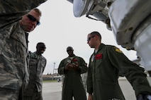 Crew members of a U.S. Air Force B-1B Lancer and maintenance Airmen from the 34th Expeditionary Aircraft Maintenance Unit at Andersen Air Base, Guam, discuss post flight maintenance at Osan Air Base, Republic of Korea, Sept. 21, 2016. The crew landed a B-1 on the Korean Peninsula for the first time since 1996, and also conducted the aircraft's closest flight to the North Korean border ever. (U.S. Air Force photo by Senior Airman Victor J. Caputo)