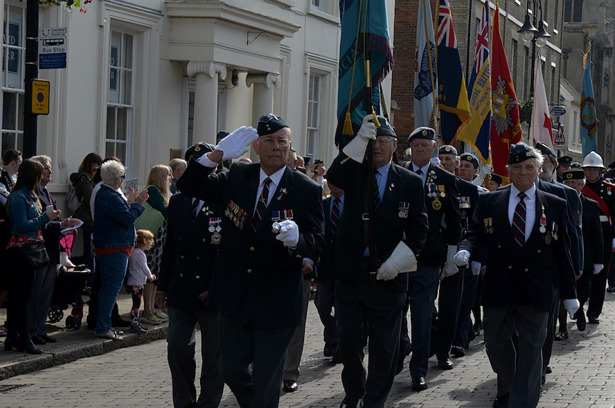 Veterans, community leaders and members of the armed forces march during the Battle of Britain parade Sept. 19, 2016, in Bury St. Edmunds, England. The parade, led by the band of the Royal Air Force Regiment, serves as a reminder of the Battle of Britain. (U.S. Air Force photo by Airman 1st Class Tenley Long)