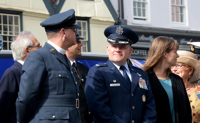 U.S. Air Force Col. Thomas Torkelson, center, 100th Air Refueling Wing commander, and his wife, Debbie, right, attend the Battle of Britain parade Sept. 19, 2016, in Bury St. Edmunds, England. The parade pays tribute to those who served in the Battle of Britain in 1940. (U.S. Air Force photo by Airman 1st Class Tenley Long)