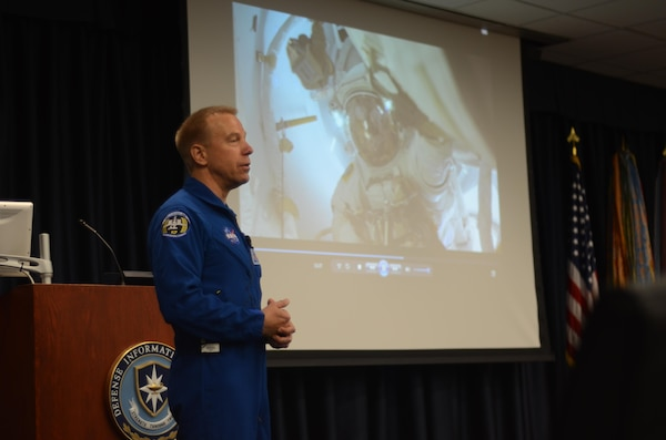 NASA astronaut Timothy L. Kopra, a flight engineer for Expedition 46 and the mission commander for Expedition 47, details his experience on board the International Space Station to faculty and students at the Defense Information School  on Sept. 13, 2016. Kopra's visit to DINFOS is part of his 180-day post-flight tour as NASA participates in public outreach operations. After his 20-minute flight video, the faculty and students asked questions ranging from the smell of the space station to what riding on a rocket was like.