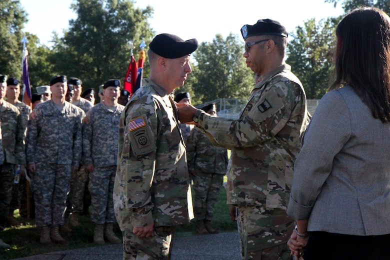 Maj. Gen. A. C. Roper, the commander of the 80th Training Command (TASS), pins the prestigious Legion of Merit on Brig. Gen. Jason L. Walrath, the outgoing commander of the 100th Training Division Operations Support, in recognition of Walrath's numerous accomplishments during his tenure as the division's commanding general. Walrath took command of the 100th Division back in September of 2014 and will go on to become the Deputy Commanding General - Support of the U.S. Army Recruiting Command. Brig. Gen. Aaron T. Brig. Gen. Aaron T. Walter assumed command of the 100th TD after Walrath formally relinquished his leadership duties during a change of command ceremony at Brooks Parade Field Fort Knox, Ky., Sept. 11, 2016.