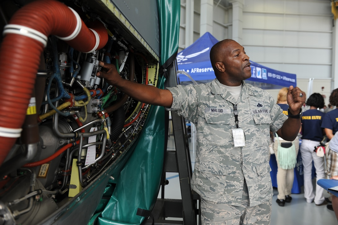 Master Sgt. Donald Maloid, 403rd Maintenance Squadron propulsion technician, provides an overview of a AE2100 D3 Rolls Royce Turbo prop engine during the Science, Technology, Engineering and Mathematics Diversity Outreach Day at the fuel cell hangar Sept. 16, 2016 on Keesler Air Force Base, Miss. The event consisted of nine Mississippi gulf coast high school Junior ROTC units and science students viewing an 81st Security Forces Squadron military working dog demonstration, participating in a pull-up competition and visiting informative booths about Air Force opportunities and accession requirements with an emphasis on STEM. (U.S. Air Force photo by Kemberly Groue/Released)