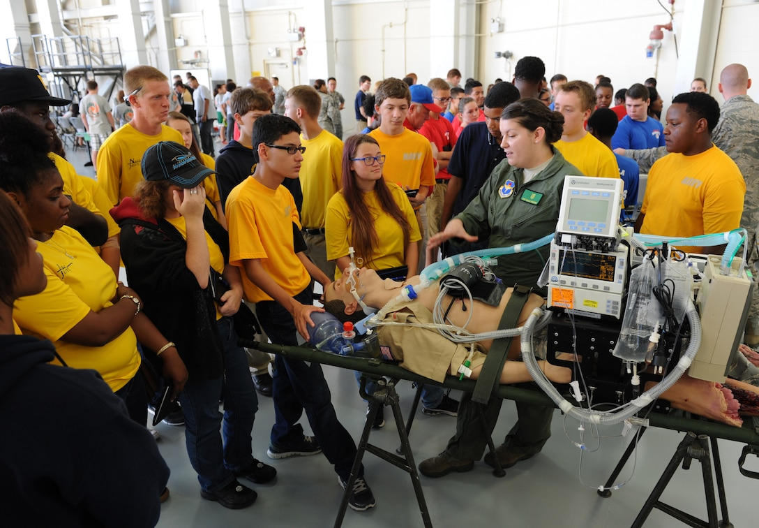 Staff Sgt. Nicole Richards, 81st Medical Operations Squadron respiratory therapy NCO in charge, provides an overview on the critical care air transport team capabilities during the Science, Technology, Engineering and Mathematics Diversity Outreach Day at the fuel cell hangar Sept. 16, 2016 on Keesler Air Force Base, Miss. The event consisted of nine Mississippi gulf coast high school Junior ROTC units and science students viewing an 81st Security Forces Squadron military working dog demonstration, participating in a pull-up competition and visiting informative booths about Air Force opportunities and accession requirements with an emphasis on STEM. (U.S. Air Force photo by Kemberly Groue/Released)