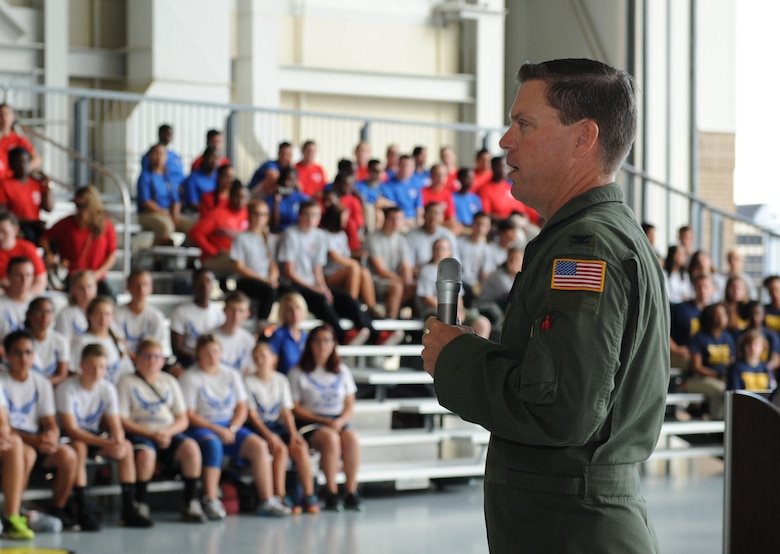 Col. C. Mike Smith, 81st Training Wing vice commander, delivers welcoming remarks to high school students during the Science, Technology, Engineering and Mathematics Diversity Outreach Day at the fuel cell hangar Sept. 16, 2016 on Keesler Air Force Base, Miss. The event consisted of nine Mississippi gulf coast high school Junior ROTC units and science students viewing an 81st Security Forces Squadron military working dog demonstration, participating in a pull-up competition and visiting informative booths about Air Force opportunities and accession requirements with an emphasis on STEM. (U.S. Air Force photo by Kemberly Groue/Released)