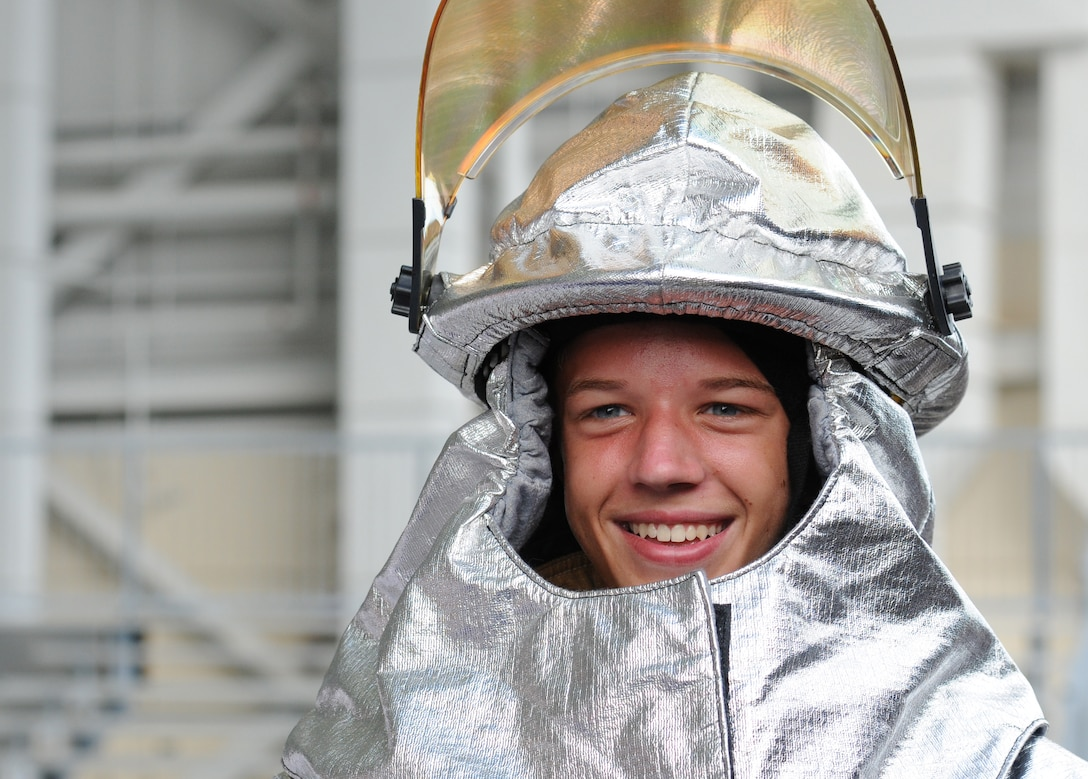 Cooper Simmons, St. Martin High School Junior ROTC student, wears a firefighter helmet during the Science, Technology, Engineering and Mathematics Diversity Outreach Day at the fuel cell hangar Sept. 16, 2016 on Keesler Air Force Base, Miss. The event consisted of nine Mississippi gulf coast high school Junior ROTC units and science students viewing an 81st Security Forces Squadron military working dog demonstration, participating in a pull-up competition and visiting informative booths about Air Force opportunities and accession requirements with an emphasis on STEM. (U.S. Air Force photo by Kemberly Groue/Released)